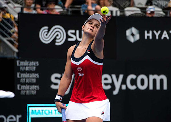 Ash Barty while serving